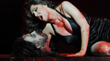 Cheryl Barker performs with the severed head of John the Baptist, during a full dress rehearsal for the Opera Australia production of Salome at the Sydney Opera House.