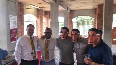 Embarrassing: Clive Eksteen and Altaaf Kazi posing with spectators wearing Sonny Bill Williams masks.