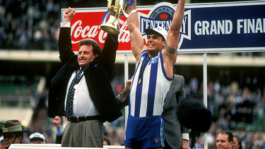 Alpha: Wayne Carey with coach Denis Pagan after the 1996 grand final.