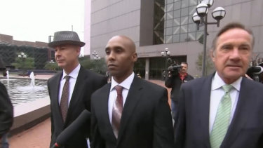 Minneapolis police officer Mohamed Noor, centre, has been charged with two counts of murder and one of manslaughter for killing Justine Ruszczyk Damond.