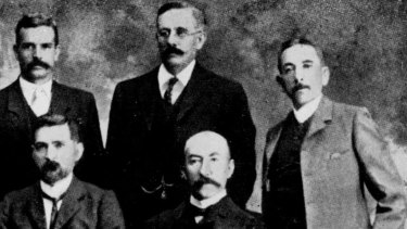 Billy Hughes, far right, and Hugh Mahon standing second from right in the first Commonwealth Labor ministry in 1904, in which Mahon was postmaster-general.