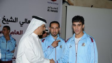 Hakeem AlAraibi with AFC president Shiekh Salman, a member of the royal family who AlAraibi has been critical of in the past.
