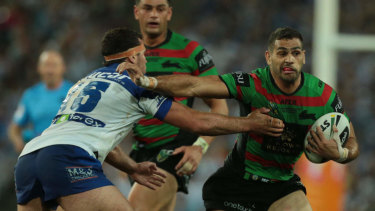 Rising above: Greg Inglis was instrumental for the Rabbitohs in their 2014 grand final victory.