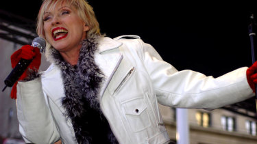 Debbie Harry, lead singer for the band Blondie, sings during a free concert in New York on Tuesday, April 6, 2004. Blondie today released their new album 'The Curse of Blondie,' the band's first studio album in five years.