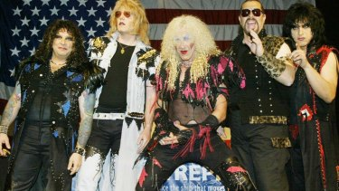 Members of the reunited metal band Twisted Sister, including Dee Snider (centre), pose for photos before a press conference in New York on April 29, 2003.