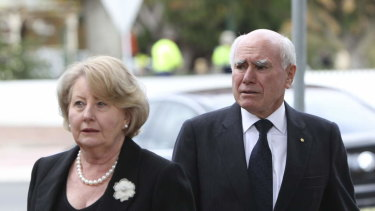 John and Jeanette Howard arrive at the funeral of Paul Ramsay at St Thomas Aquinas Church, Bowral.