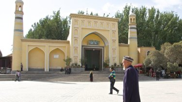 An elderly Uighur man in front of Kashgar\'s Id Kah mosque in Xinjiang, China.