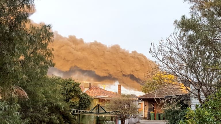 Smoke billows from a West Footscray factory, seen from Kingsville.