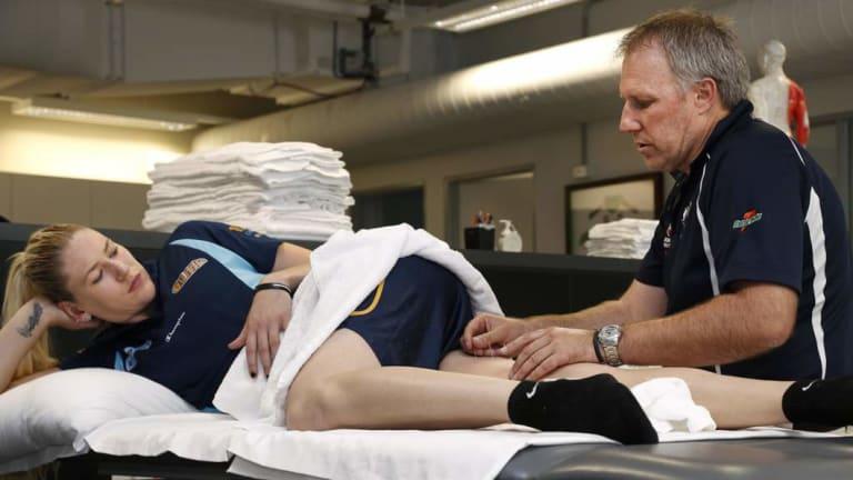 Jackson is treated by physiotherapist Tony Ward.