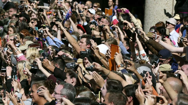 Crowds of well-wishers try to capture images of Prince William and the Duchess of Cambridge during their visit to Sydney.