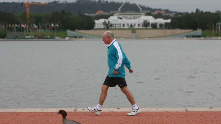 Former prime minister John Howard was a familiar figure power walking in the streets.