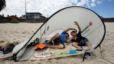 A beach tent blows over on Middle Park beach.