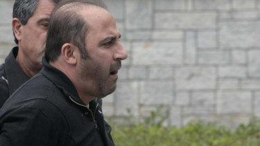Tony Mokbel arrives at Athens' Korydallos prison in May 2008 before being flown back to Australia.