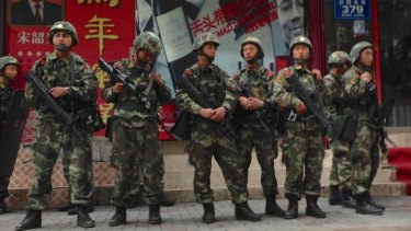 A paramilitary police patrol in Xinjiang.