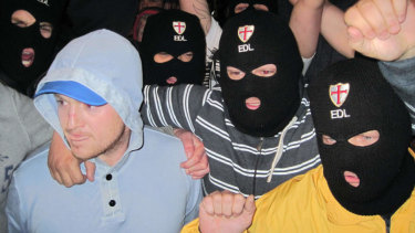Far-right group, English Defence League leader, Tommy Robinson, left, with EDL supporters.