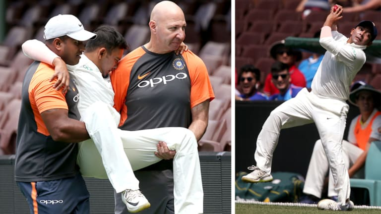 Casualty: India's PrithviShaw is taken from the field after badly rolling his ankle (right).