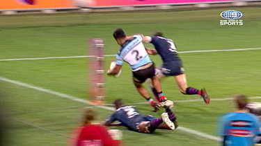 Charged: Billy Slater will face the judiciary over his tackle on Sosaia Feki in the preliminary final.
