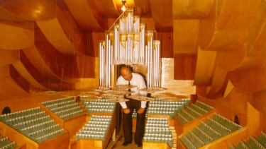 Photograph of Dr Vilhelm Jordan in a model of the Concert Hall dated 13 November 1981.