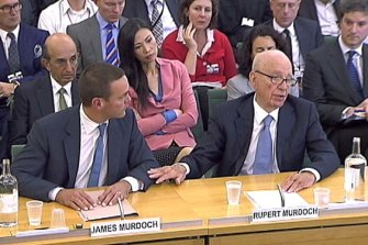 James and Rupert Murdoch appear before a British parliamentary committee on phone hacking in July 2011.