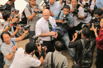 Dunkley faces reporters in Yangon before being jailed.