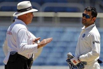 Umpire Daryl Harper with Mahendra Singh Dhoni.