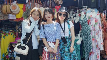 Chen Lizhu with her friends at Tanah Lot Temple in Bali.