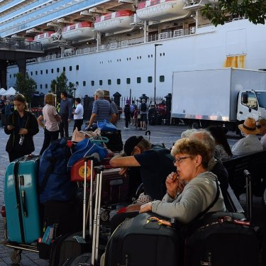 Passengers disembark unchecked from the Ruby Princess cruise ship on March 19 at Sydney's Circular Quay.