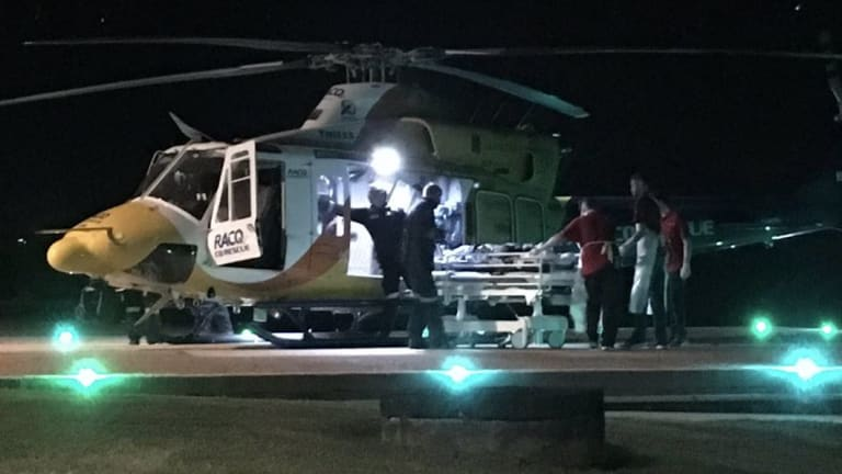 The RACQ CQ Rescue helicopterlands at Mackay Base Hospital with the shark attack victim.