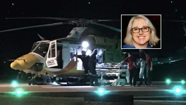 The RACQ CQ Rescue helicopter lands at Mackay Base Hospital with shark attack victim Justine Barwick, inset.