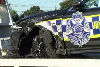 The smashed police car on Sunday morning.