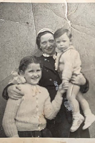 "Joan Burton with her adoptive mother and brother. When she tried to find her birth mother, one nun – who knew her identity – refused, telling her to ""go home""."