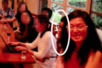 Nick Zhao (circled) sitting next to Federal Liberal MP Gladys Liu at a meeting at her house in 2016.