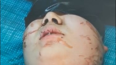 A still from the video Jingwang Ye's father received of his son.