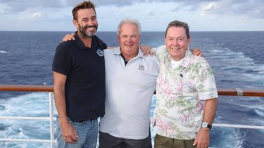 Safe on a cruise ship: Ben Johnson, left, and Chris and Kevin Doran were aboard the yacht when it sank after hitting a tug rope.