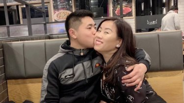 Mr Tran and his mother Amy.