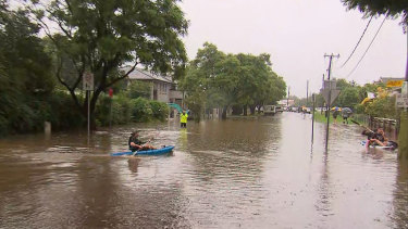 People kayaking through the streets of Penrith on Sunday.