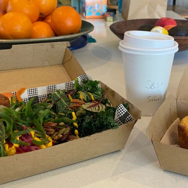 The veggie grain bowl with fried chicken, butterscotch latte, and Portuguese tart from Kickaboom café in Glenbrook.