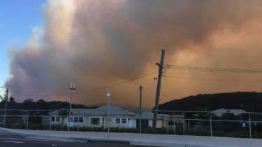 A bushfire burns in Milton near Ulladulla on the NSW South Coast.