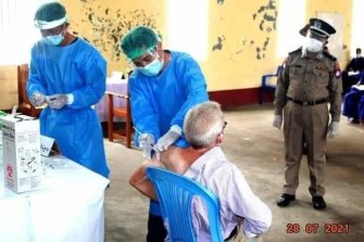 Turnell receives a shot of the vaccine at Insein Prison, according to a military-run newspaper.