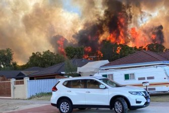 The fire is threatening homes.