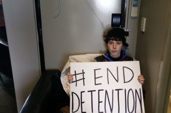 A refugee activist barricaded in a Mantra hotel room on Tuesday.
