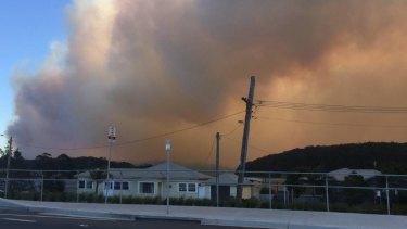 A bushfire burns in Milton near Ulladulla on the NSW South Coast.