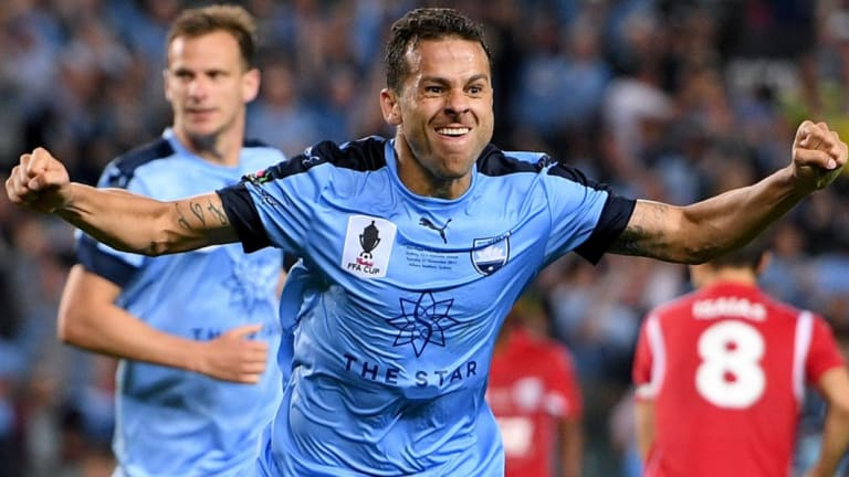Sharpshooter: Bobo scores the winner in the FFA Cup final against Adelaide.