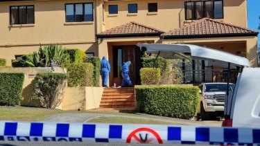 Detectives and forensic officers at the Brisbane home of rugby union player Toutai Kefu on Monday.