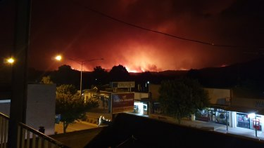 Photos taken from the balcony of the Courthouse Hotel of fire moving towards Corryong earlier this week.