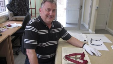 Peter Collins, Convenor of the Canon David Garland memorials, with the Pectoral Cross.