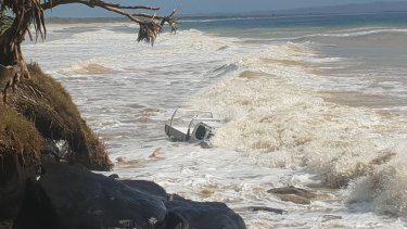 A ute was caught in the big swell near Mudlo Rocks at Rainbow Beach.