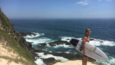 Dane Davidson was surfing with Sam Edwardes when he was attacked by a shark.