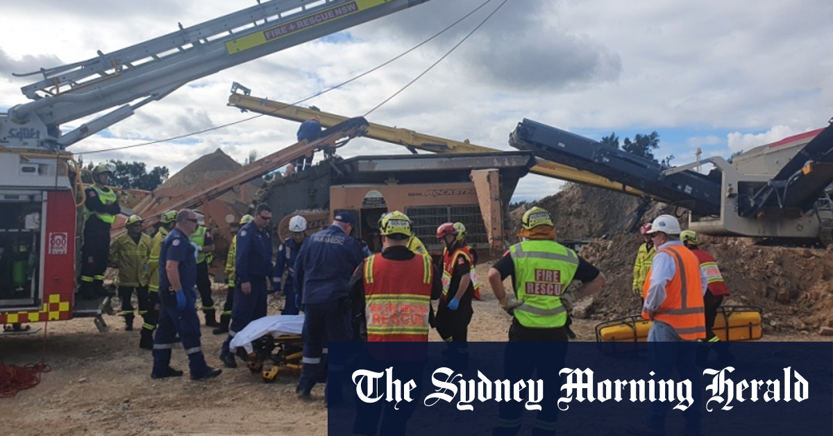 Man injured after becoming trapped in rock crushing machinery – Sydney Morning Herald