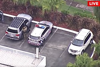 Police are searching for the man in an exclusion zone in Ormeau on the Gold Coast on Tuesday.